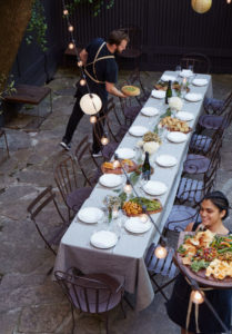 Setting up for private garden dinner at Maison May Dekalb in Brooklyn
