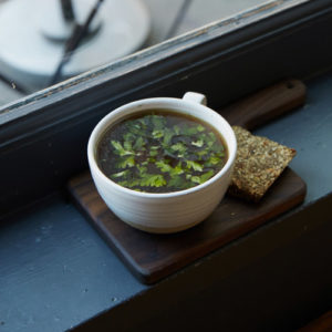 Seasonal consommé for lunch in Brooklyn café with outdoor seating