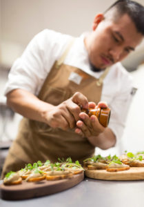 Chef Armando Reyes preparing seasonal event dish