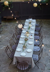 Outdoor dinner party in Brooklyn Brownstone garden