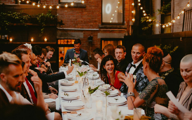 Outdoor wedding rehearsal dinner in exquisite Brooklyn Brownstone
