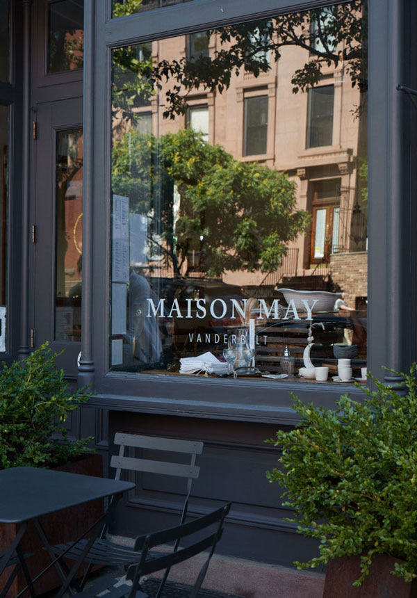 Maison May Vanderbilt outdoor cafe terrace and shop