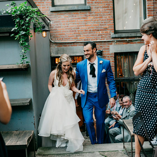 A joyful bride and groom after their Brownstone garden ceremony