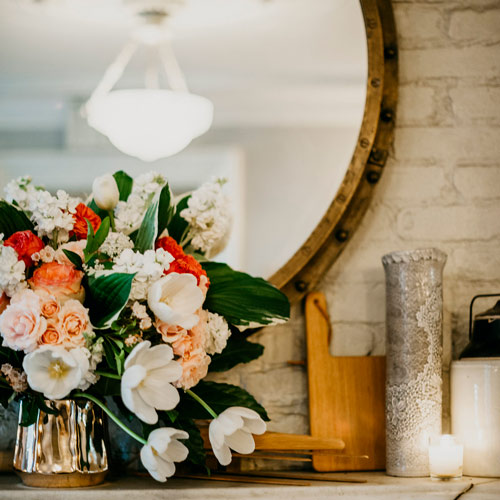 Flowers and candles create intimate wedding atmosphere at Maison May